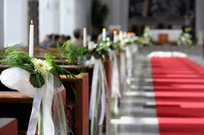 Wedding Flowers on Pews in Church