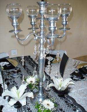 candelabra with candles and beads